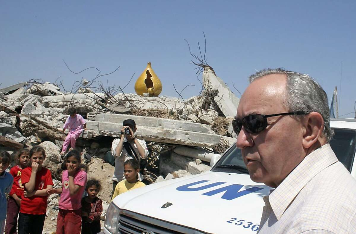 FILE - In this June 3, 2009, file photo, UN investigator Richard Goldstone visits the destroyed house where members of the Samouni family were killed in an artillery strike during Israel's offensive in January in Gaza City. A U.N. war crimes report against Israel and Hamas meant to promote justice and accountability has instead created new obstacles for the Obama administration's Mideast peace push and deepened an internal rift among Palestinians. (AP Photo/Ashraf Amra, File)