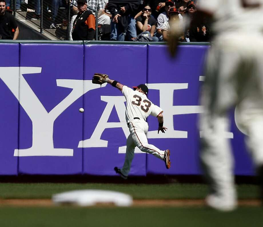 Aaron Rowand can't get to a hit by Skip Schumaker that scored two Cardinals in the 6th inning at AT&T Park on Sunday. Photo: Brant Ward, The Chronicle