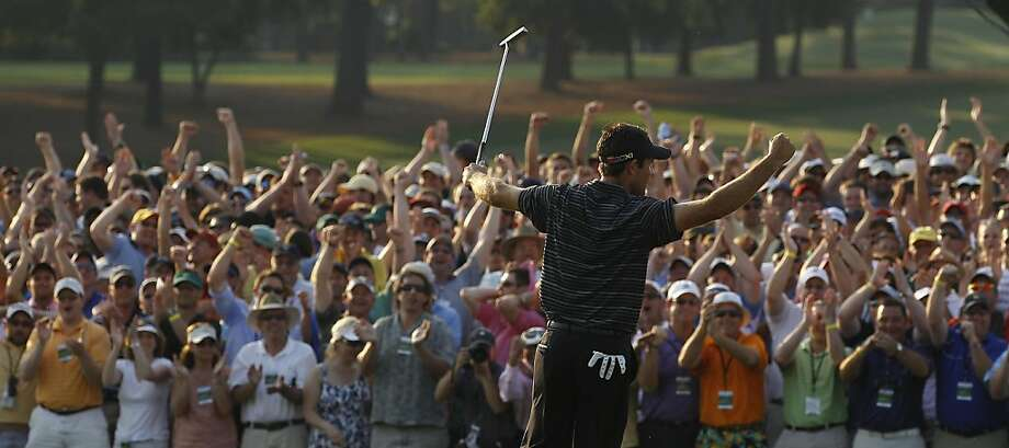 Charl Schwartzel of South Africa reacts after a birdie putt on the 18th hole during the final round of the Masters golf tournament Sunday, April 10, 2011, in Augusta, Ga. Photo: Matt Slocum, AP