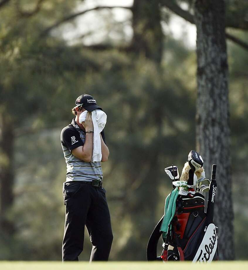 Rory McIlroy of Northern Ireland wipes his face during the final round of the Masters golf tournament Sunday, April 10, 2011, in Augusta, Ga. Photo: Matt Slocum, AP