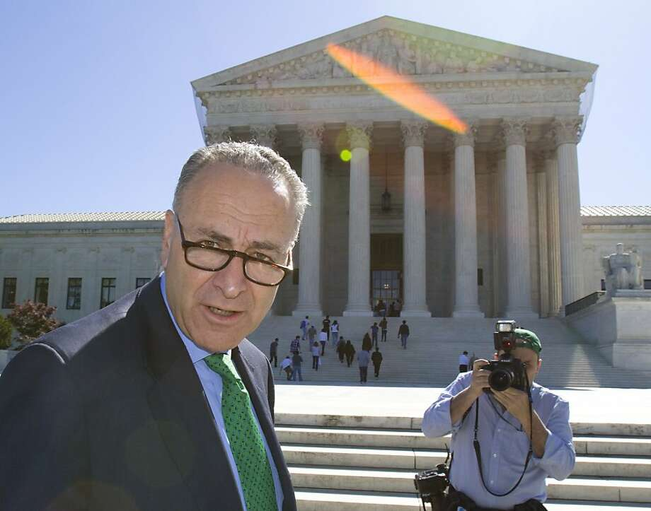 Sen. Charles Schumer, D-N.Y. arrives at the Supreme Court in Washington, Thursday, April 29, 2010, for a campaign finance news conference. Photo: Harry Hamburg, AP
