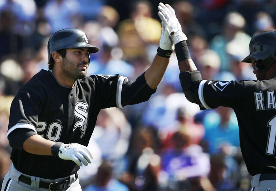 Chicago White Sox's Carlos Quentin (20) celebrates a solo home run with teammate Alexei Ramirez (10) during the eighth inning of a baseball game against the Kansas City Royals in Kansas City, Mo., Wednesday, April 6, 2011. Photo: Orlin Wagner, AP