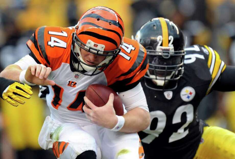 Bengals quarterback Andy Dalton (left) has a 17-12 touchdown-to-interception ratio this season. Photo: AP