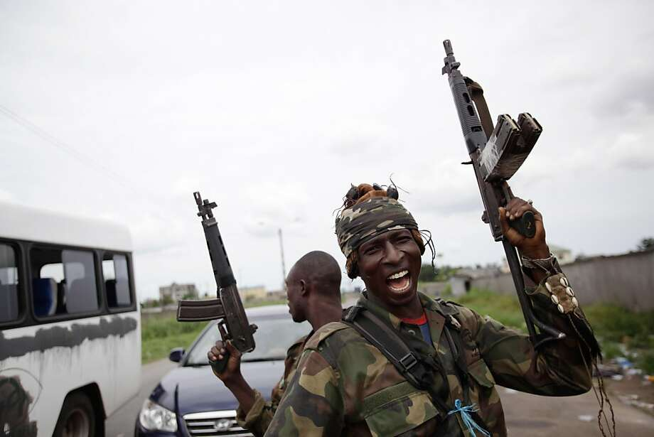 Issiaka Diakhite, 26, who says he took up arms after his parents were killed by Laurent Gbagbo loyalists in his home town of Daloa in November, reacts as soldiers loyal to Alassane Ouattara man a checkpoint at one of the principal entrances to Abidjan, Ivory Coast, Tuesday, April 5, 2011. Ivory Coast's entrenched strongman Gbagbo huddled in a bunker at his home and was exploring different options for his surrender, officials said Tuesday, as forces backing the country's democratically elected leader seized the residence. Photo: Rebecca Blackwell, AP