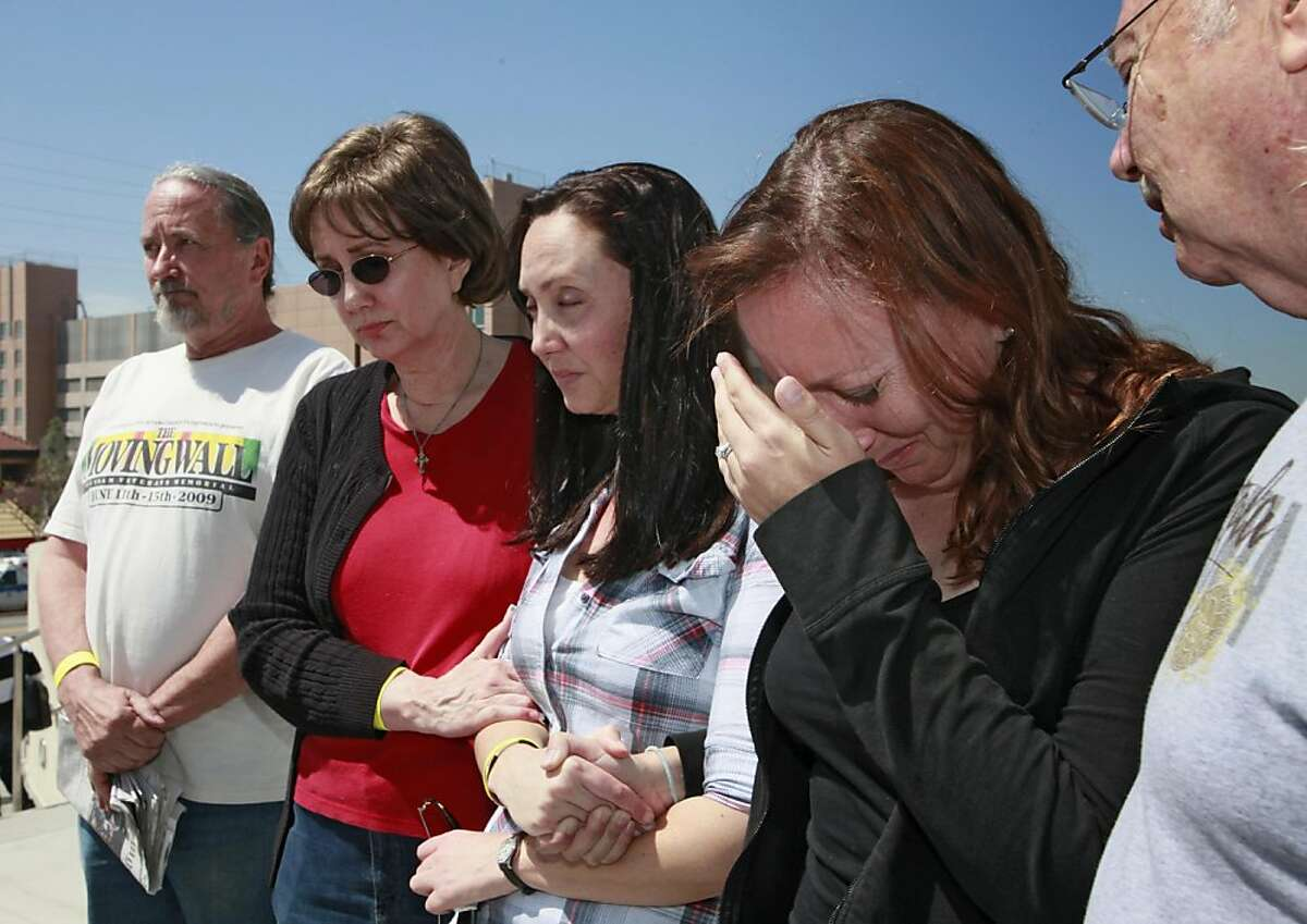 Family members of attacked Giant fan, Bryan Stow, gather for a news conference outside USC Hospital Tuesday April 5, 2011 in Los Angeles. They are, from left, John Devitt, uncle, Elizabet Stow, mother, Bonnie Stow, sister, Erin Stow, sister and Dave Stow,father. According doctors, Bryan Stow is showing signs of brain damage and remains in critical condition.