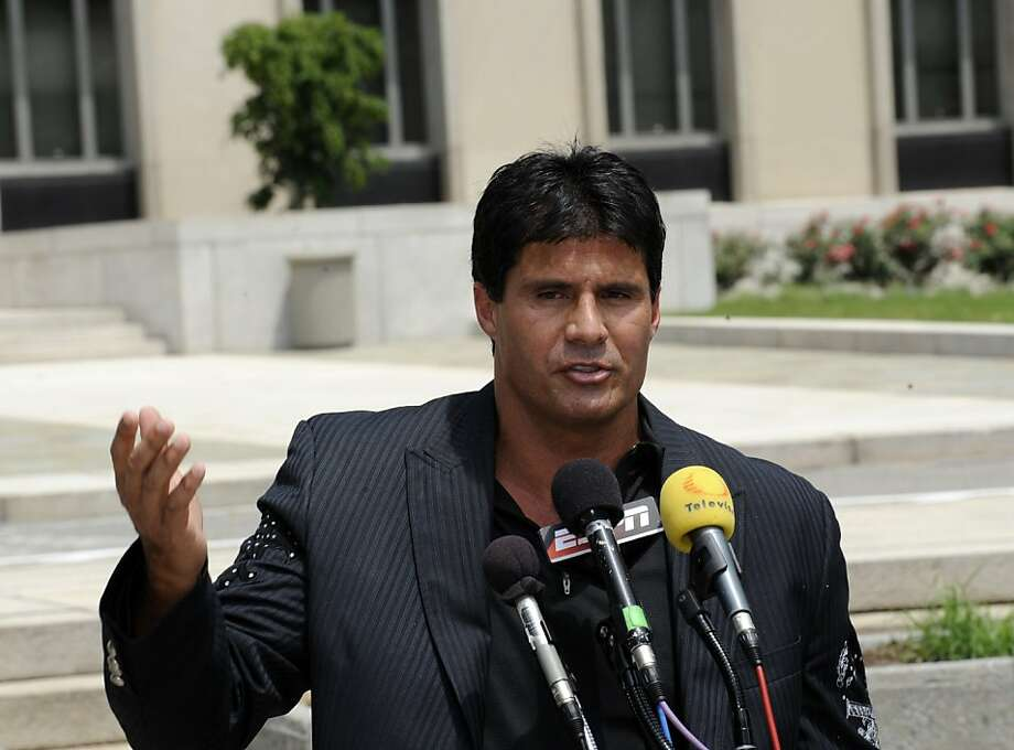 Jose Canseco talks with reporters after appearing in federal court in Washington, Thursday, June 3, 2010. (AP Photo/Susan Walsh) Photo: Susan Walsh, AP