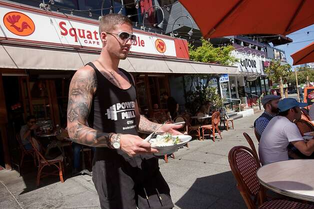 Ronnie Waite of San Francisco brings his salad to his table at the parklet in front of the Squat & Gobble Cafe and Crepery on 16th and Market Street  April 4, 2011 in San Francisco, Calif.  Photograph by David Paul Morris/Special to the Chronicle Photo: David Paul Morris, Special To The Chronicle