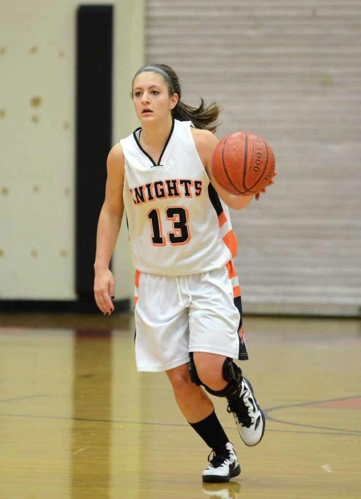 Stamford's Kelsey Cognetta (13) dribbles the ball during the season opener girls basketball game against Bassick at Stamford High School on Wednesday, Dec. 7, 2011.