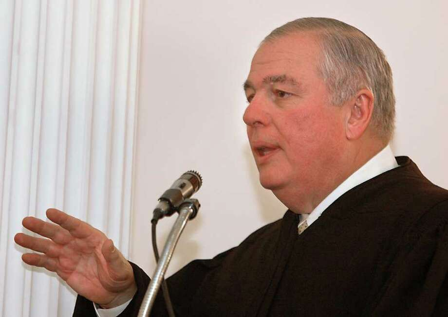 Times Union staff photo by Lori Van Buren -- Honorable Anthony V. Cardona talks about the late Peter Porco, his Chief Law Clerk, after being administered the oath of office  by Chief Judge Judith Kaye at the Albany County Courthouse in Albany, NY on February 22, 2005. Photo: LORI VAN BUREN / ALBANY TIMES UNION