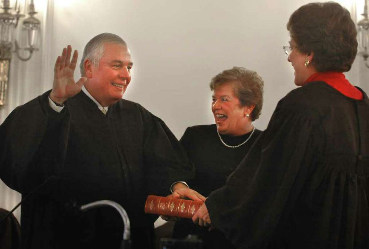 Times Union staff photo by Lori Van Buren Honorable Anthony V. Cardona is administered the oath of office by Chief Judge Judith Kaye, right, at the Albany County Courthouse in Albany, NY on February 22, 2005. Cardona's wife, Aline Cardona, gets a chuckle out of something funny.