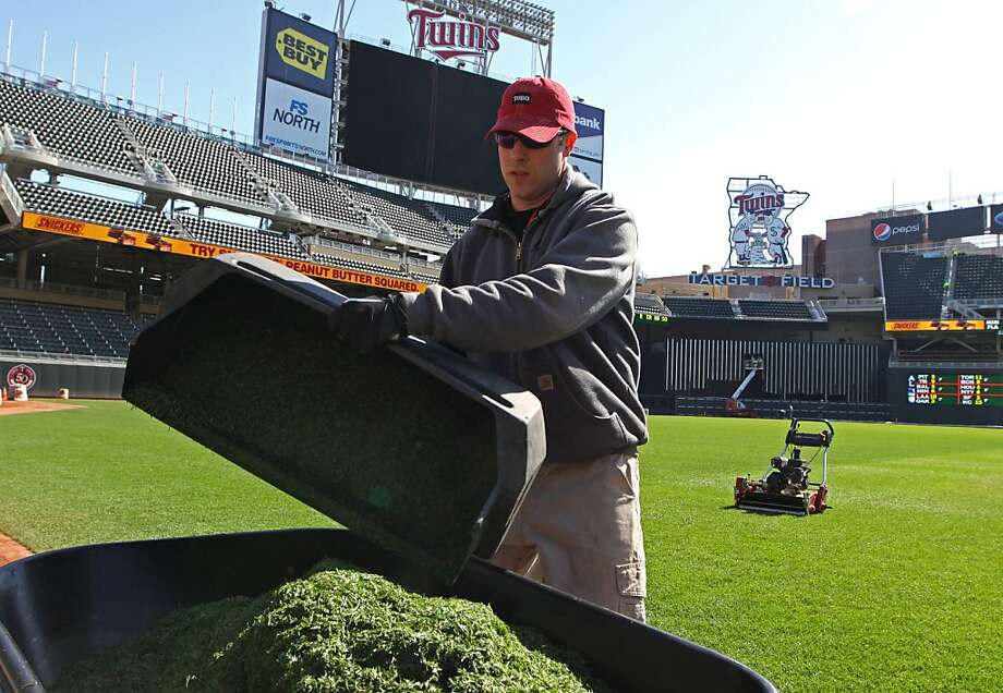 Target Field grounds crew member Tyler Carter helps prepare for the Minnesota Twins Opening Day baseball at the ballpark Wednesday, March 30, 2011 in Minneapolis. Photo: Bruce Bisping, AP