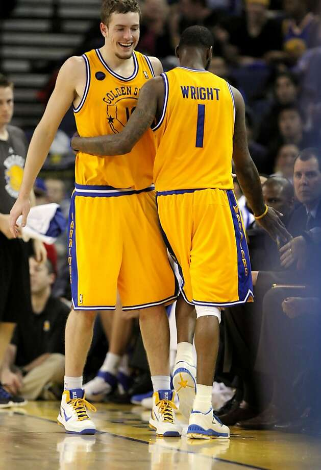 Dorrell Wright, right, gets a hug from teammate, David Lee after Wright came out of the game in the final minutes. The Golden State Warriors played the New Orleans Hornets at Oracle Arena in Oakland, Calif., on Tuesday, February 15, 2011. Photo: Carlos Avila Gonzalez, The Chronicle