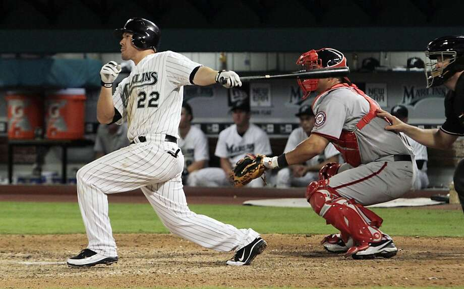 Florida Marlins' Donnie Murphy (22) singles in the 10th inning to drive the winning run home during the game against the Washington Nationals in Miami, Tuesday, April 5, 2011. The Marlins won 3-2 in the 10th inning. Photo: J Pat Carter, AP