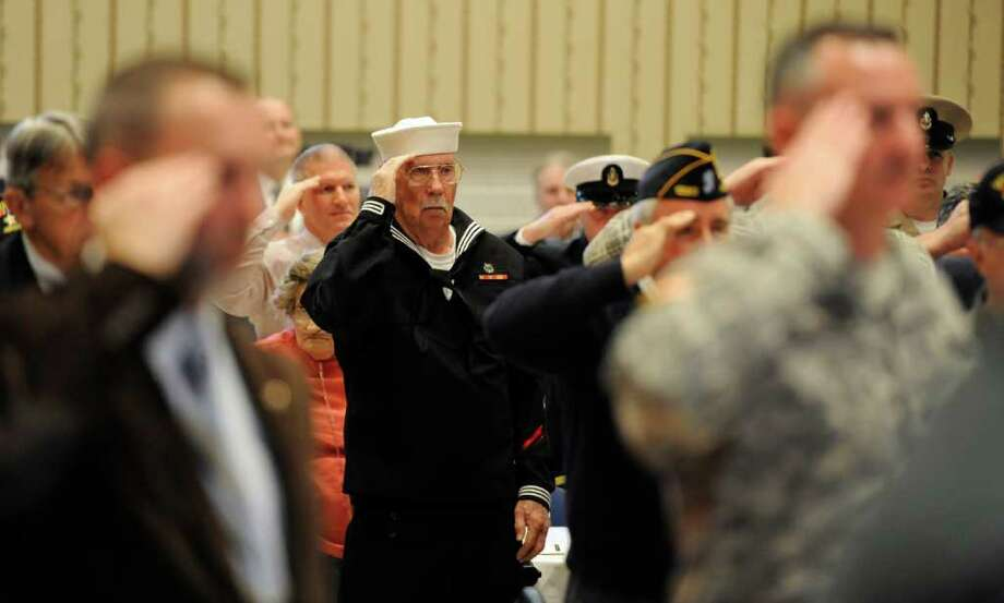 All members of the military both veteran and in service salute at the playing of the National Anthem at the 70th Anniversary of Pearl Harbor Day Memorial Observance held at the Zaloga Post in Albany, N.Y. Dec. 7, 2011.  (Skip Dickstein / Times Union) Photo: SKIP DICKSTEIN / 10015687A
