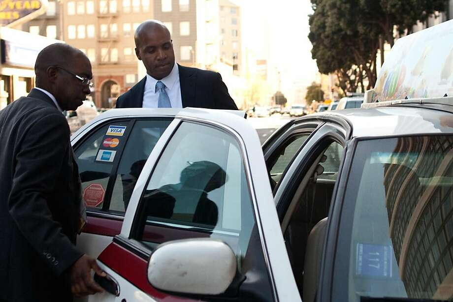 Former major league baseball player Barry Bonds (right) leaves the Phillip Burton Federal Building and United States Court House on April 4, 2011 in San Francisco, Calif.  Photograph by David Paul Morris/Special to the Chronicle Photo: David Paul Morris, Special To The Chronicle
