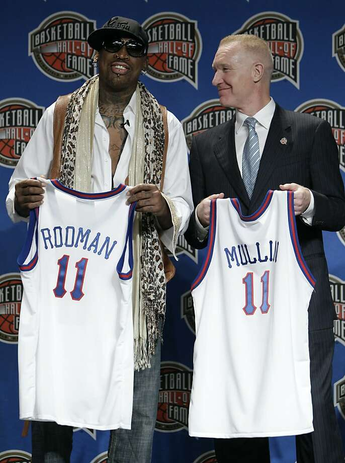 Dennis Rodman and Chris Mullin, right, look on during the Naismith Memorial Basketball Hall of Fame class announcement, Monday, April 4, 2011, in Houston. Photo: Charlie Neibergall, AP