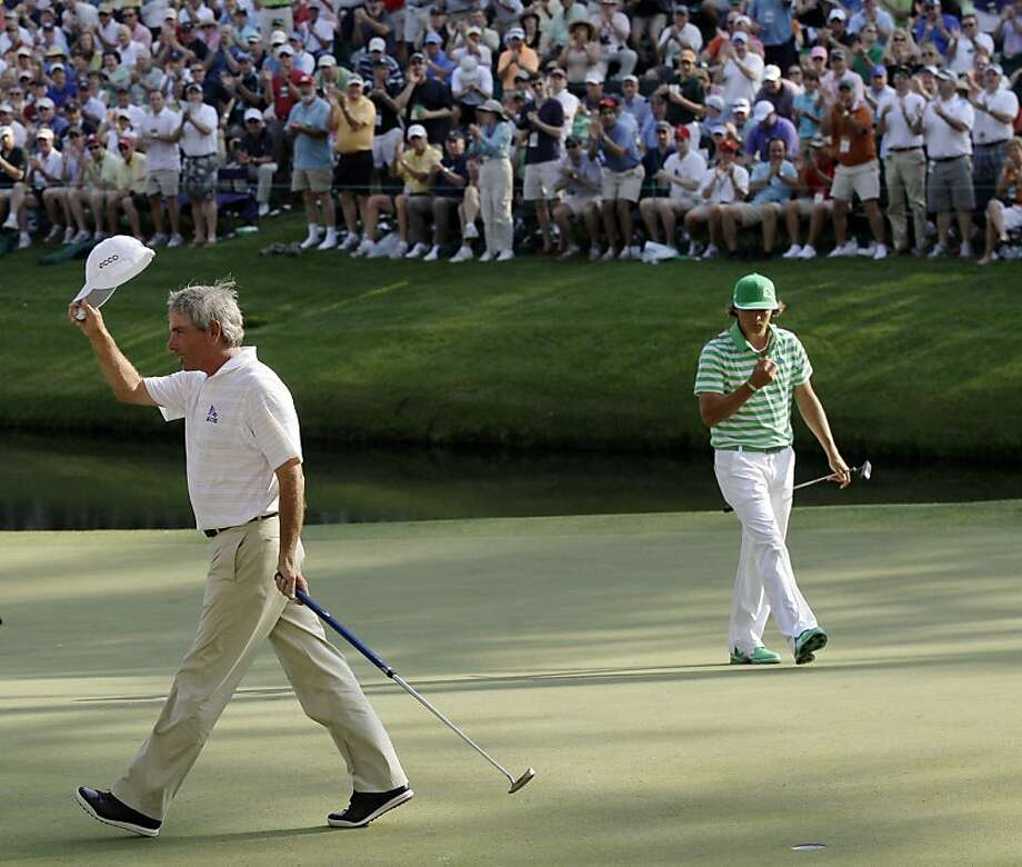 Fred Couples tips his cap after a birdie on the 16th hole during the third round of the Masters golf tournament Saturday, April 9, 2011, in Augusta, Ga. Rickie Fowler is on the right. Photo: Dave Martin, AP