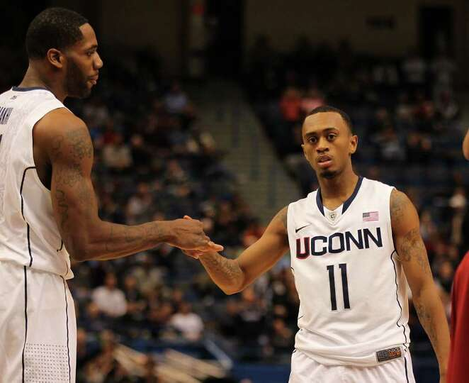 UConn's Ryan Boatright, right, is congratulated by Alex Oriakhi after a basket during Saturday's