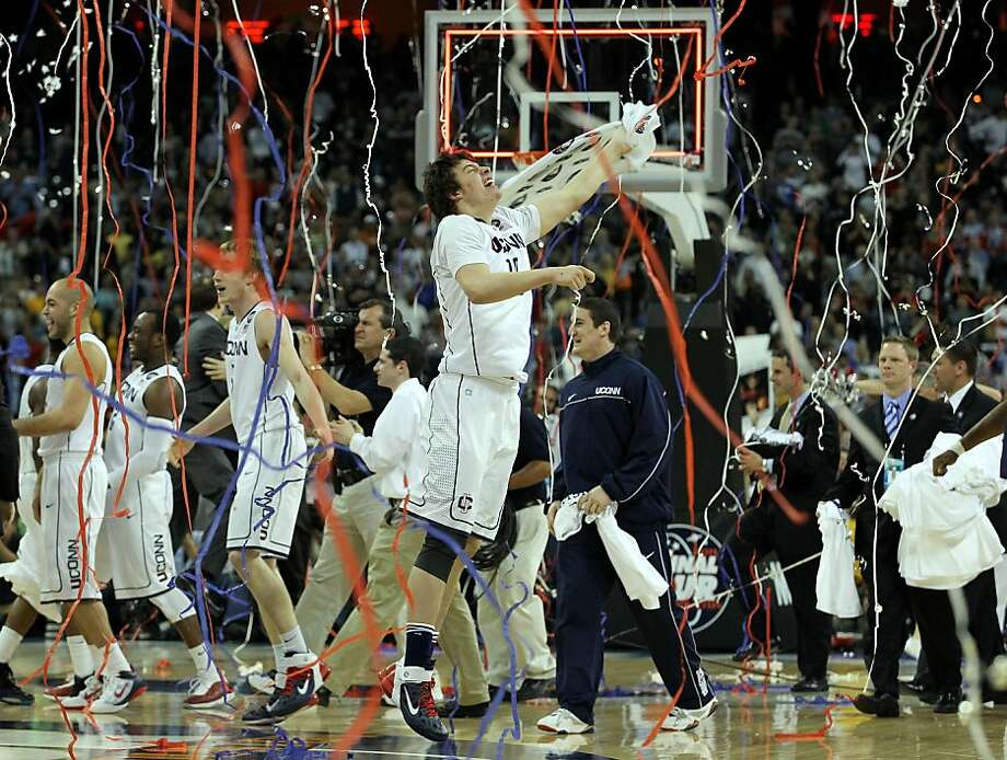 HOUSTON, TX - APRIL 04:  Tyler Olander #10 of the Connecticut Huskies reacts after defeating the Butler Bulldogs to win the National Championship Game of the 2011 NCAA Division I Men's Basketball Tournament by a score of 53-41 at Reliant Stadium on April4, 2011 in Houston, Texas. Photo: Ronald Martinez, Getty Images