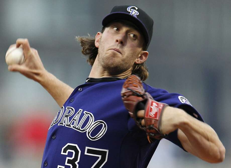 Colorado Rockies pitcher Greg Reynolds throws in the first inning of a baseball game against the Pittsburgh Pirates in Pittsburgh on Saturday, April 9, 2011. Photo: Gene J. Puskar, AP