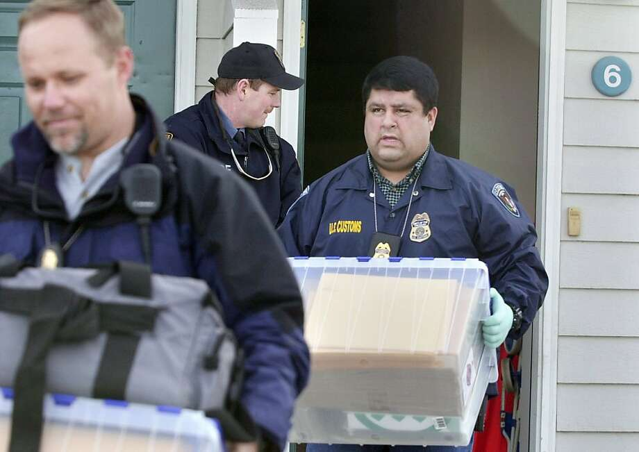 FILE - In a Feb. 26, 2002 file photo, FBI and U.S. Customs agents remove evidence from the home of University of Idaho graduate student Sami Omar Al-Hussayen in Moscow, Idaho, before he was charged with providing material support to terrorists. A fellow student, Abdullah Al-Kidd, was arrested in 2003 as he tried to board a flight to Saudi Arabia to study Arabic and Islamic law. Al-Kidd was never charged with a crime, but prosecutors wanted him to testify against Sami Omar Al-Hussayen, who was acquitted ofterrorism charges but agreed to be deported for visa fraud. Photo: Kevin German, Associated Press