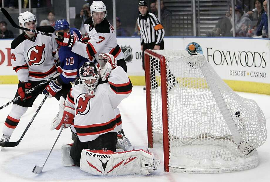 New Jersey Devils goalie Martin Brodeur, foreground, Mark Fayne, left,  Henrik Tallinder, (7) of Sweden, and New York Rangers' Marian Gaborik, (10) of the Czech Republic,  watch as a goal by Ryan McDonagh hits the net during the second period of an NHL hockey game Saturday, April 9, 2011 at Madison Square Garden in New York.  The Rangers won 5-2. Photo: Mary Altaffer, AP