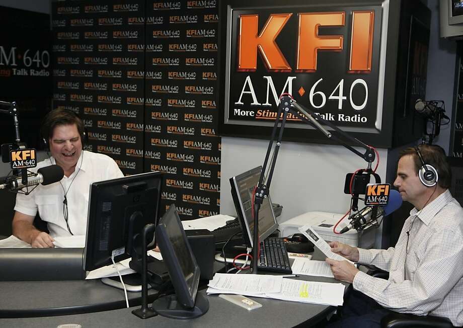 In this photo taken Wednesday, March 9, 2011, KFI AM 640 Radio's John Kobylt, left, and Ken Chiampou, record their radio show at their station in Burbank, Calif. The pair's conservative-minded audience has a track record of making life uncomfortable, evenmiserable, for politicians who lose the pair's favor. Photo: Damian Dovarganes, AP