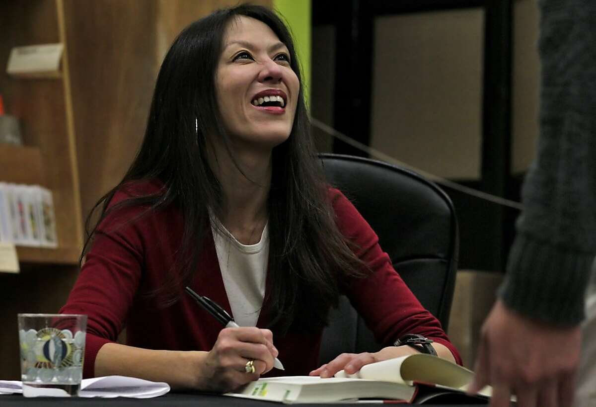 Author Amy Chua, signs her latest book,