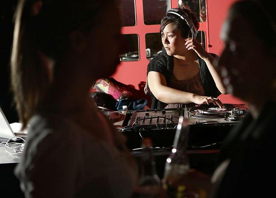 "DJ Diane ""DeeAndroid"" Medina of Peaches, spinning on Thursday, March 31,  in San Francisco, Calif., at Skylark bar. Photo: Liz Hafalia, The Chronicle"
