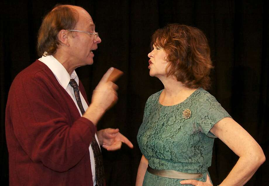 "George (Tom Woosnam) and Martha (Pennell Chapin) go at each other in Edward Albee's ""Who's Afraid of Virginia Woolf?"" at Coastal Repertory Theatre Photo: Greet Jaspaert"