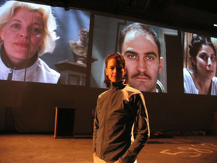 "During a rehearsal, director Kim Collier stands on the ""No Exit"" set, with the cast (from left: Lucia Frangione, Andy Thompson and Laara Sadiq) projected on screens behind her. ""No Exit"" is part of the American Conservatory Theater season. Photo by Nathan Medd. Photo: Nathan Medd"