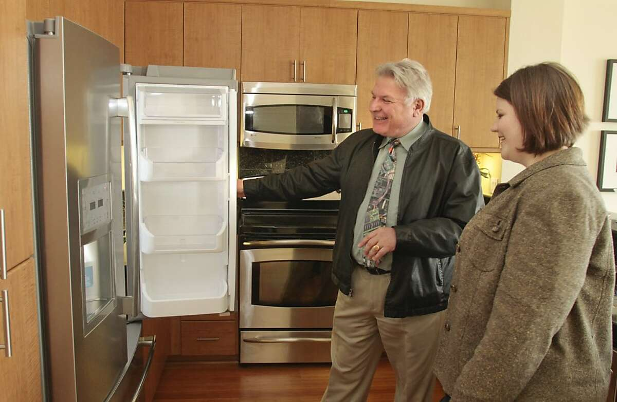 Realtor Antoine Pirson shows a condominium to Kalyn Farris in Oakland, Calif., on April 8th, 2011. Story about condo sales.