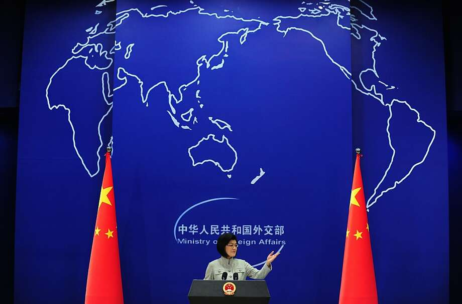 Chinese foreign ministry spokeswoman Jiang Yu gestures during a press briefing in Beijing on March 22, 2011 where China reiterated its opposition to the use of force in Libya amid Western air strikes there and called for an immediate ceasefire in the country's conflict. The government spokeswoman, however, did not make clear whether she was referring to a ceasefire by Western powers or repeating China's earlier calls for a halt of hostilities between the government and rebels in the North African state. Photo: Frederic J. Brown, AFP/Getty Images