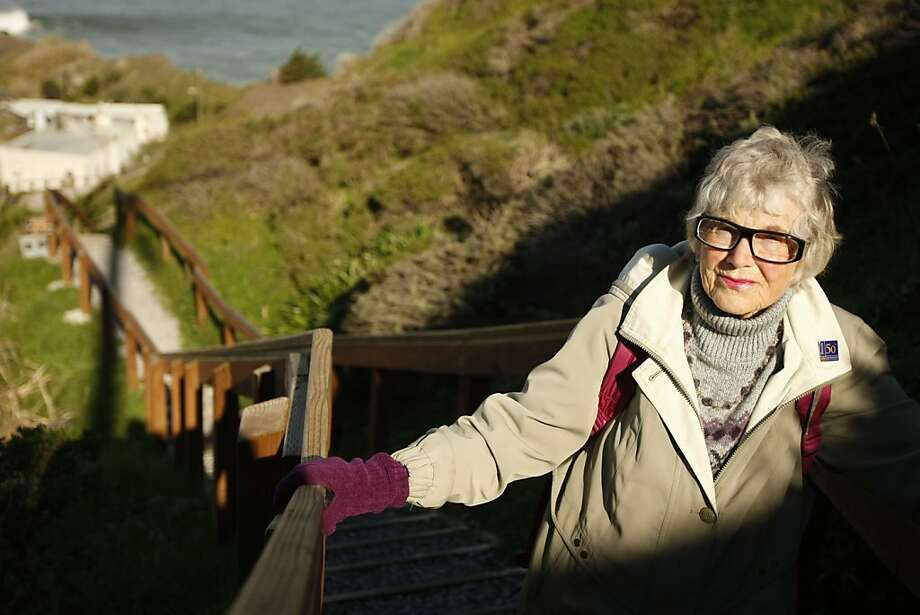 Mary Harris, 93, makes her way up the cliff behind her Pacifica home to the road that leads to her bus stop on Saturday, Jan. 22, 2011. Her healthy obsession is the steep hill and 160 step staircase she must climb in order to check her mail, do her recycling and shop. Photo: Alex Washburn, The Chronicle