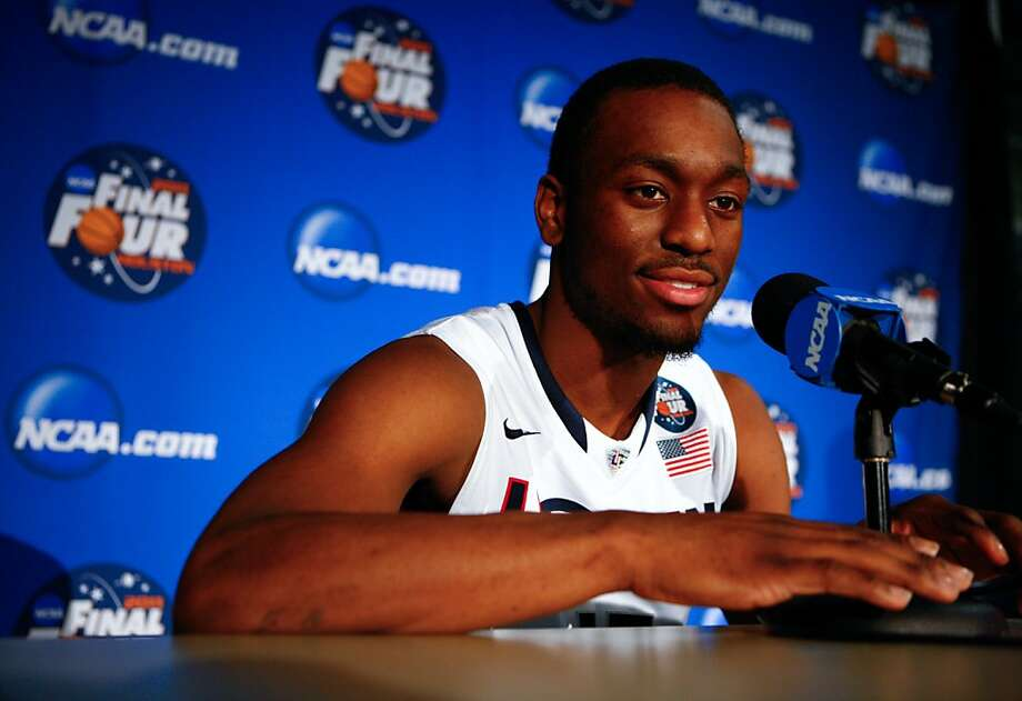 The University of Connecticut guard Kemba Walker talks about graduating from college early during media day Sunday, April 3, 2011, in Reliant Stadium in Houston.  The University of Connecticut is playing Butler University for the NCAA Men's National Championship Monday. ( Nick de la Torre / Houston Chronicle ) Photo: Nick De La Torre, Houston Chronicle