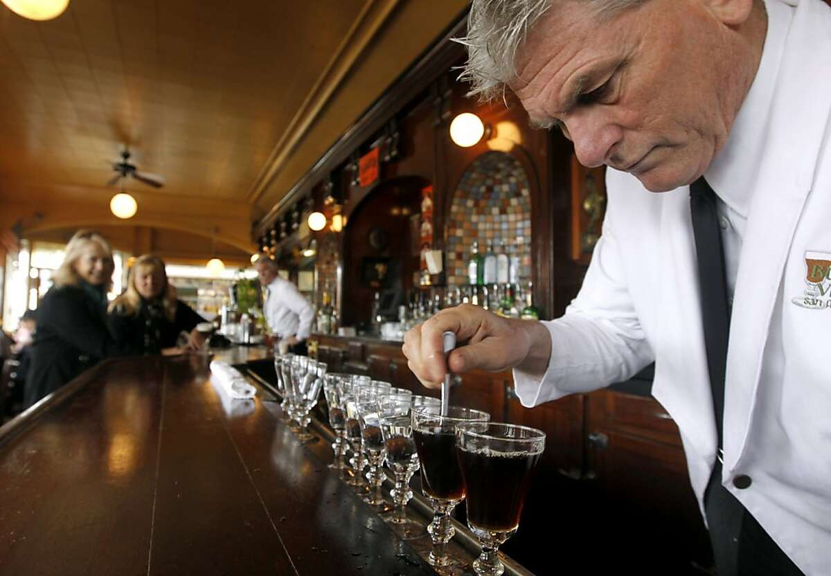 Bartender Paul Nolan mixes two sugar cubes with black coffee before adding Irish whiskey and cream for a world famous Irish coffee drink at the Buena Vista Cafe in San Francisco, Calif. on Saturday, April 2, 2011. The venerable watering hole cornered the market on the original glasses when the manufacturer decided to stop making them. They now have a manufacturer in China but, according to management, aren't quite the same quality.