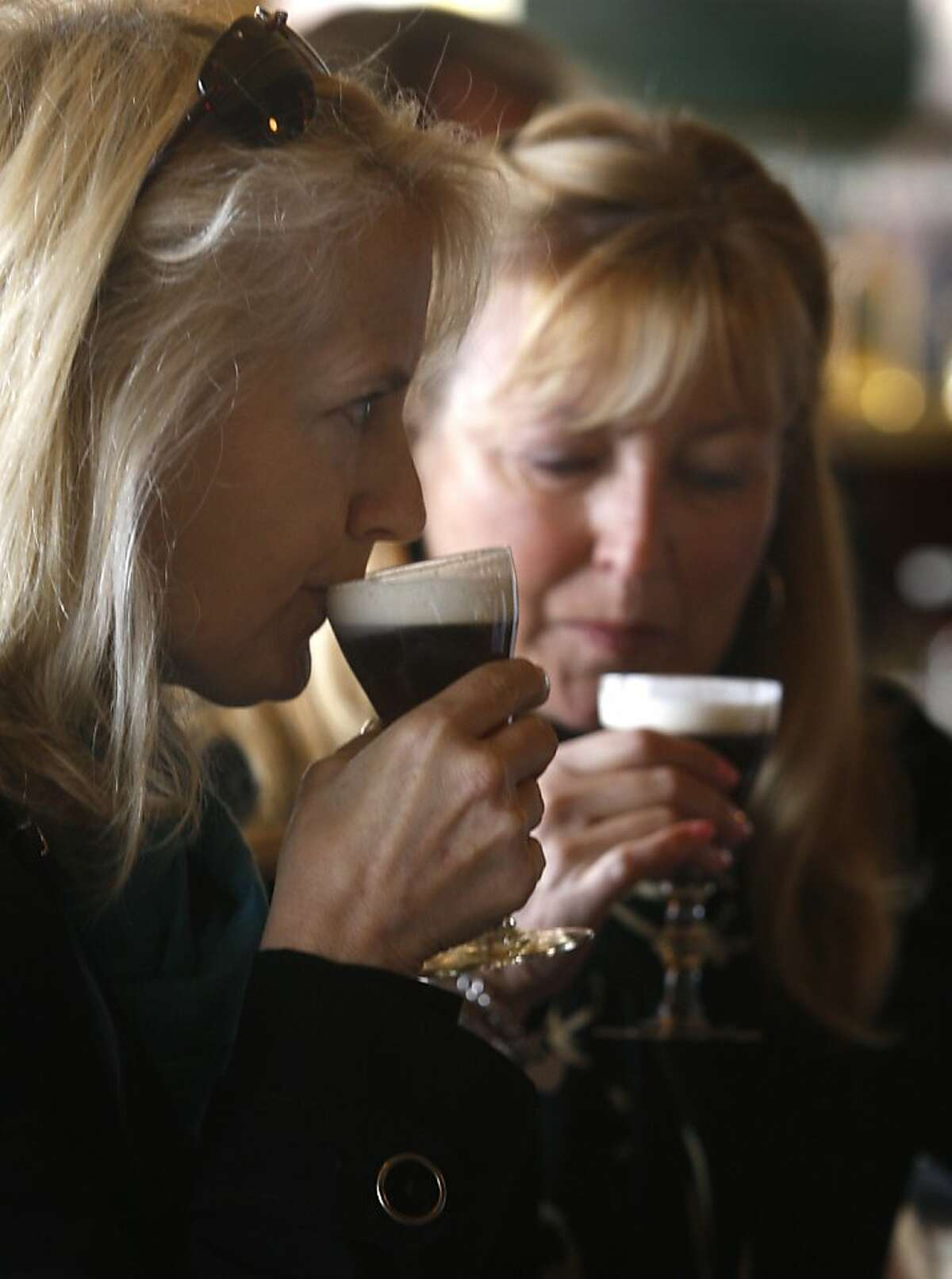 Leslie Cardenas (left) and Tina Murchison savor Irish coffee drinks at the Buena Vista Cafe in San Francisco, Calif. on Saturday, April 2, 2011. The venerable watering hole cornered the market on the original glasses when the manufacturer decided to stop making them. They now have a manufacturer in China but, according to management, aren't quite the same quality.
