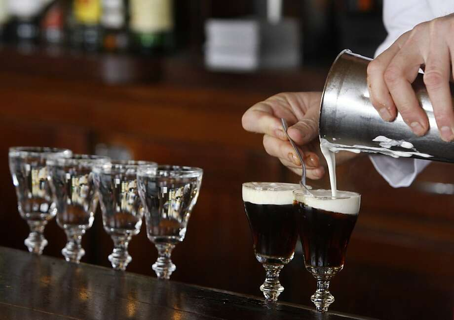 Bartender Paul Nolan adds cream to Irish coffees at the Buena Vista Cafe in San Francisco, Calif. on Saturday, April 2, 2011. The venerable watering hole cornered the market on the original glasses when the manufacturer decided to stop making them. They now have a manufacturer in China but, according to management, aren't quite the same quality. Photo: Paul Chinn, The Chronicle