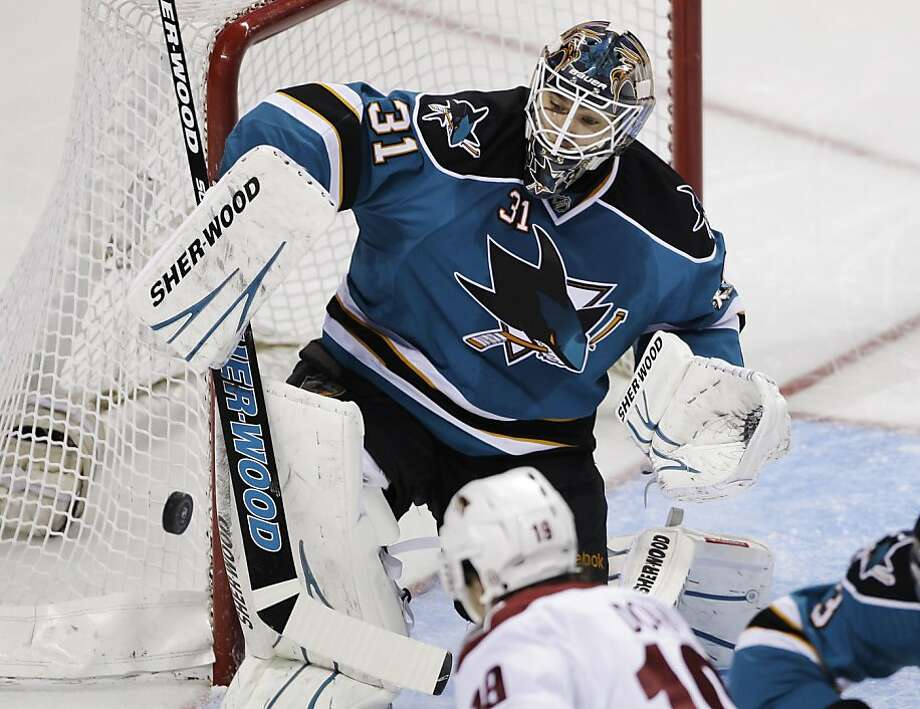 San Jose Sharks goalie Antti Niemi (31) blocks a shot by a Phoenix Coyotes player in the second period of an NHL hockey game in San Jose, Calif., Saturday, April 9, 2011. Photo: Paul Sakuma, AP