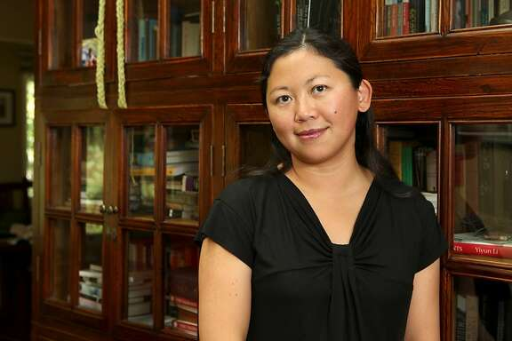 Author, Yiyun Li, one of this year's recipients of a $500,000 MacArthur genius grant award poses for a portrait at her Oakland home on Monday, September 27, 2010.   Kat Wade / Special to the Chronicle