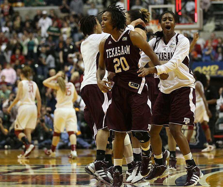 INDIANAPOLIS, IN - APRIL 03:  Tyra White #20 of the Texas A&M Aggies celebrates the win with her teammates after the game against the Stanford Cardinal during the semifinals of the 2011 NCAA Women's Final Four on April 3, 2011 at Conseco Fieldhouse in Indianapolis, Indiana. The Texas A&M Aggies defeated the Stanford Cardinal 63-62. White scored the game winning basket. Photo: Elsa, Getty Images
