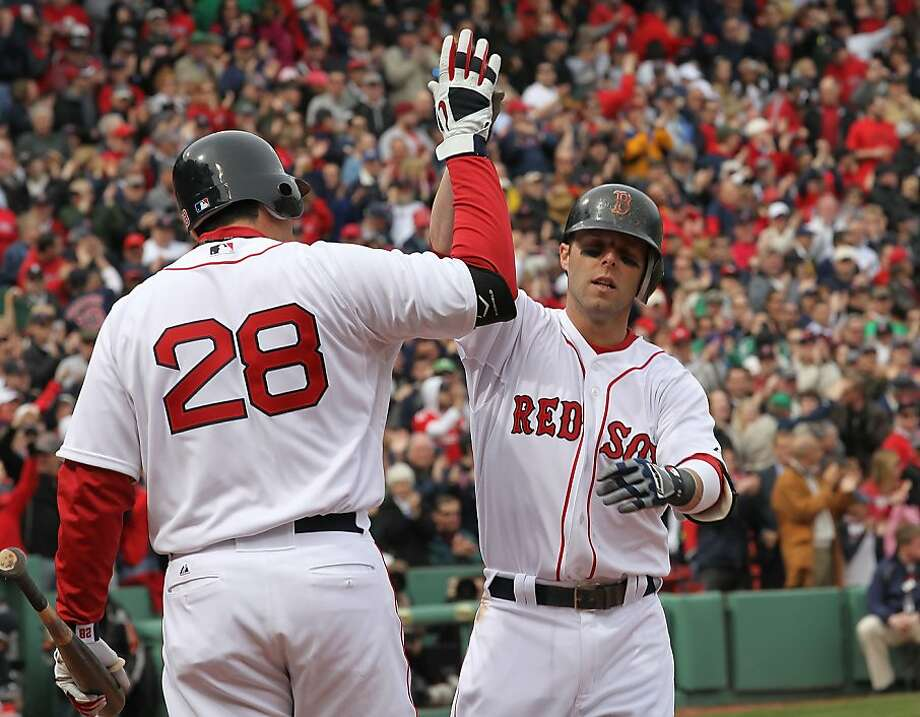 BOSTON, MA - APRIL 8:  Dustin Pedroia # 15 ofthe Boston Red Sox celebrates with a teammate after hitting a home run against the New York Yankees in the first inning on Opening Day at Fenway Park on April 8, 2011 in Boston, Massachusetts. Photo: Jim Rogash, Getty Images