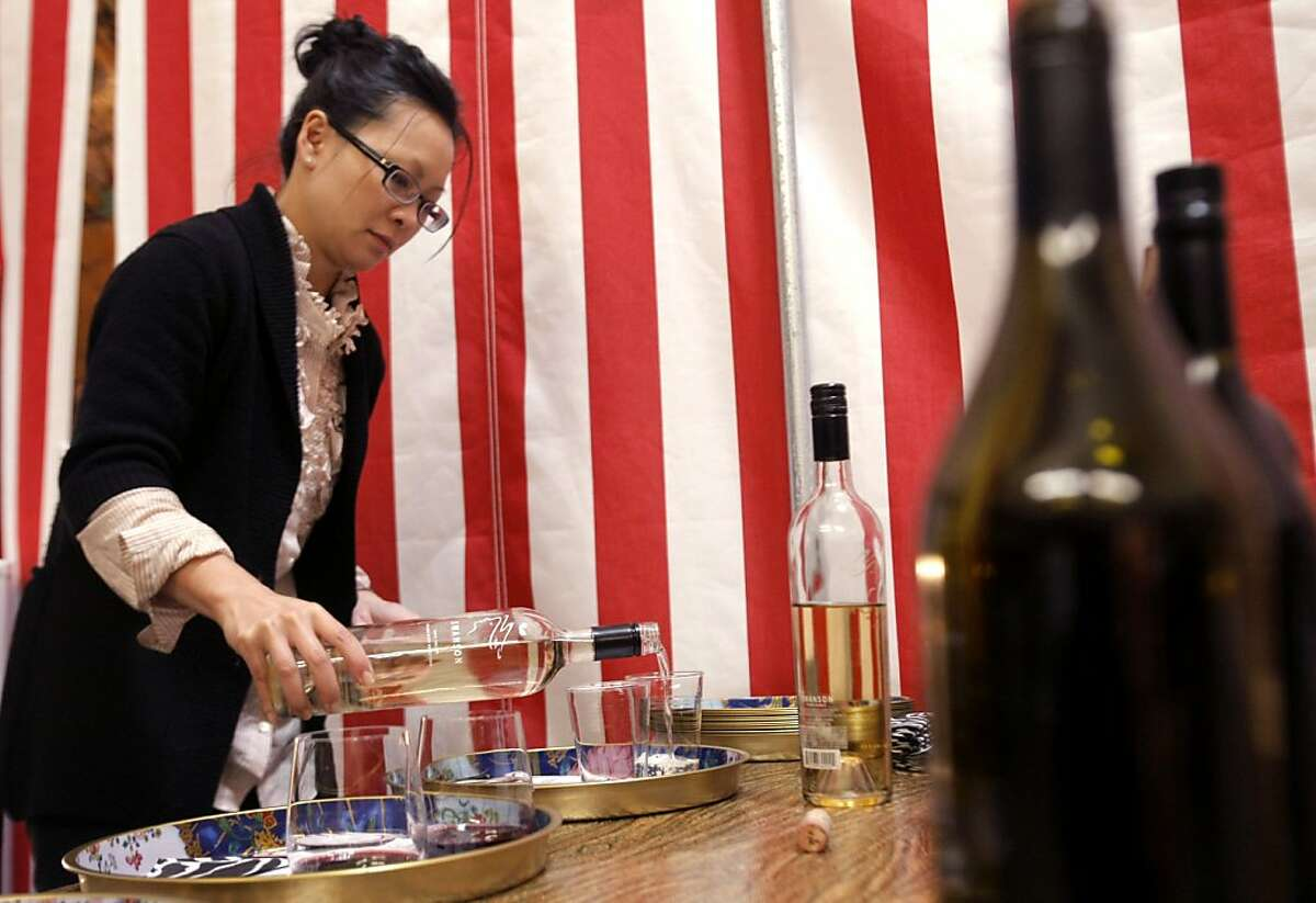 Katie Sieu pours samples of wine at Swanson Vineyards' Sip Shoppe in Napa County, Calif., on Sunday, February 27, 2011.