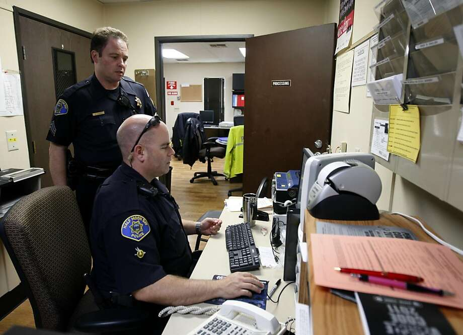 Sgt. Dennis Loubal and officer Richard Cheechov - the only police officers working the day shift - check background information on a person of interest in Half Moon Bay, Calif. on Friday, April 1, 2011. The department currently employs only eight officers, four sergeants and a part-time chief of police. Photo: Paul Chinn, The Chronicle