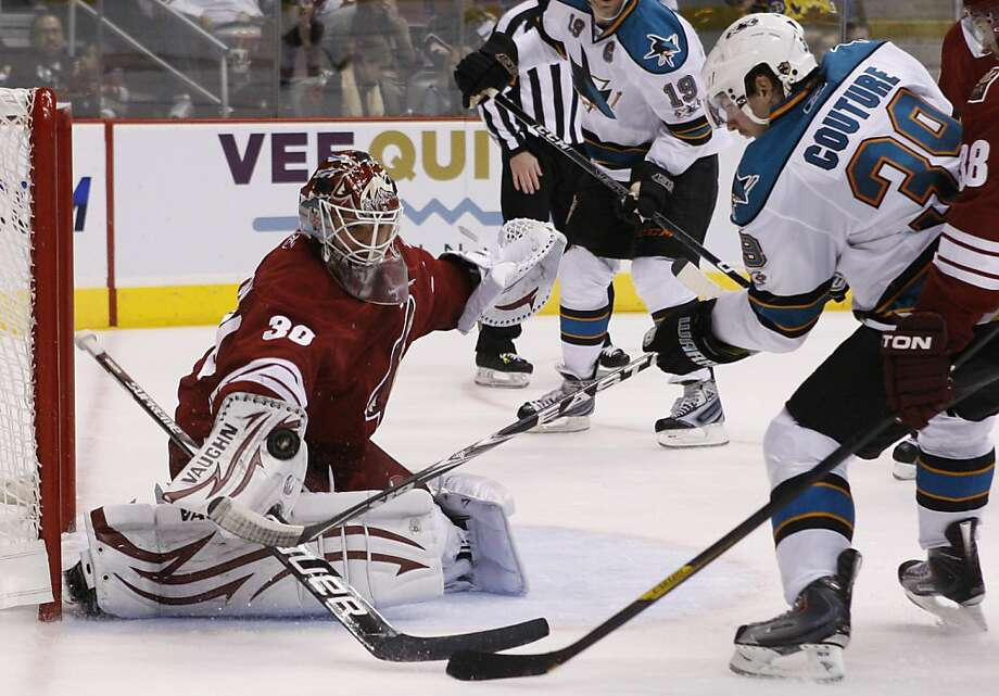 Phoenix Coyotes' Ilya Bryzgalov (30), of Russia, makes a save on a shot by San Jose Sharks' Logan Couture (39) during the third period of an NHL hockey game Friday, April 8, 2011, in Glendale, Ariz.  The Coyotes defeated the Sharks 4-3. Photo: Ross D. Franklin, AP