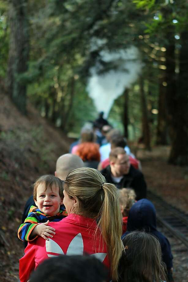 Ian Barrie, 18 mos, giggles in his mother, Giovana Zanellato's arms while along with his siter, Chloe Barrie, 5, they ride the Redwood Valley Railway steam train in Tilden Regional Park in Berkeley, Calif. on Monday, March 14, 2011.    Kat Wade / Special to the Chronicle Photo: Kat Wade, Special To The Chronicle