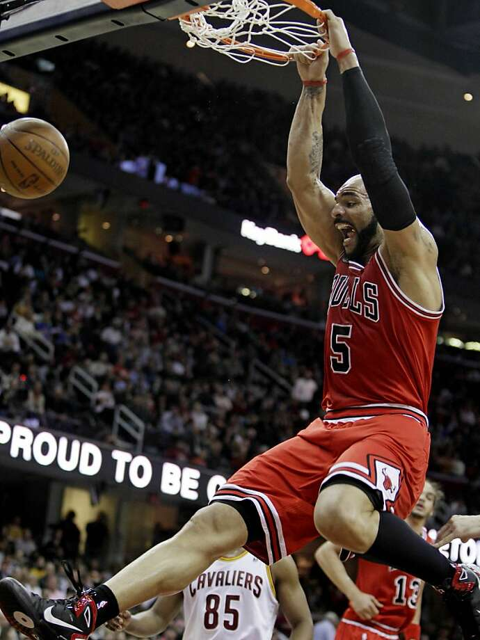 Chicago Bulls' Carlos Boozer dunks the ball in the first quarter in an NBA basketball game against the Cleveland Cavaliers Friday, April 8, 2011, in Cleveland. The Bulls won 93-82. Photo: Tony Dejak, AP