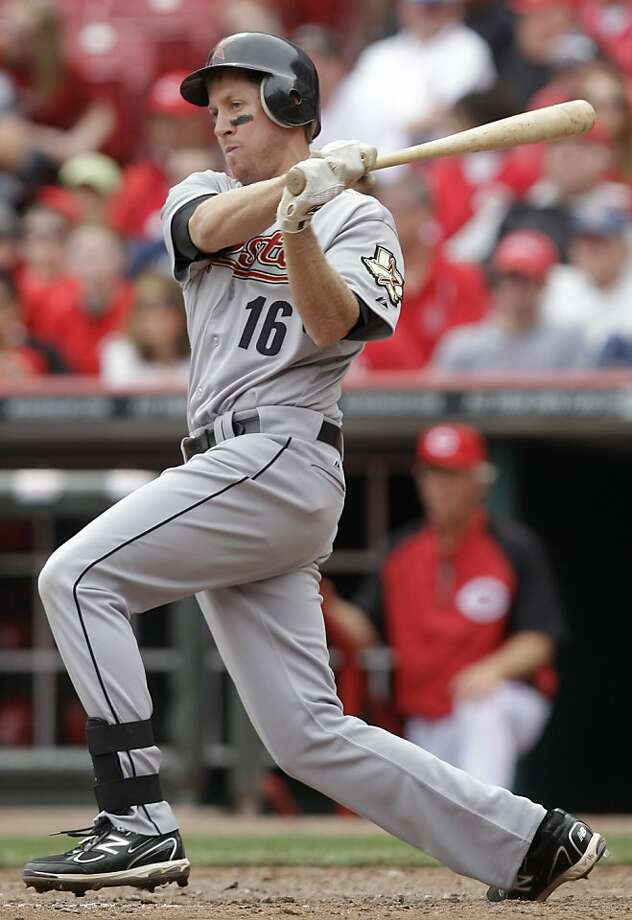** THIS CORRECTS THAT DOWNS HIT A DOUBLE, NOT A SINGLE ** Houston Astros' Matt Downs hits a double off Cincinnati Reds relief pitcher Nick Masset to drive in a run in the ninth inning of a major league baseball game, Thursday, April 7, 2011 in Cincinnati.Houston won 3-2. Photo: Al Behrman, AP