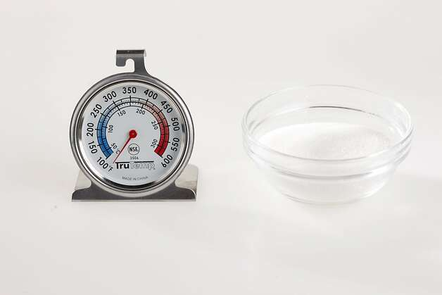 Oven thermometer and small dish of sugar as seen in San Francisco, California, on Friday, March 23, 2011. Photo: Craig Lee, Special To The Chronicle