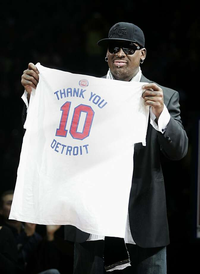 Former Detroit Piston Dennis Rodman holds up a t-short with his number 10 to thank the fans during a ceremony to retire his jersey at an NBA basketball game against the Chicago Bulls Friday, April 1, 2011, in Auburn Hills, Mich. Photo: Duane Burleson, AP